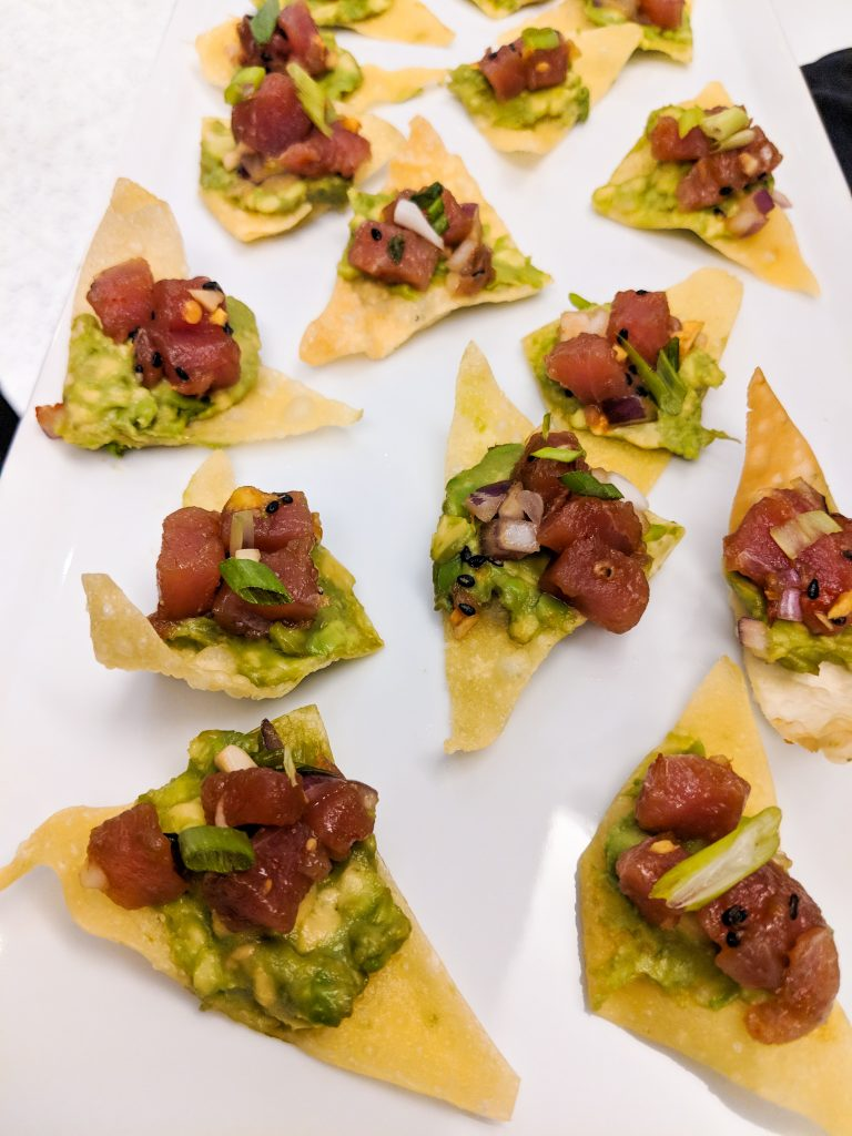 Swift + Co Catering Ahi Tuna Poke on a crispy wonton chip